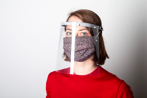 Woman with a face mask face shield during covid 19 protection